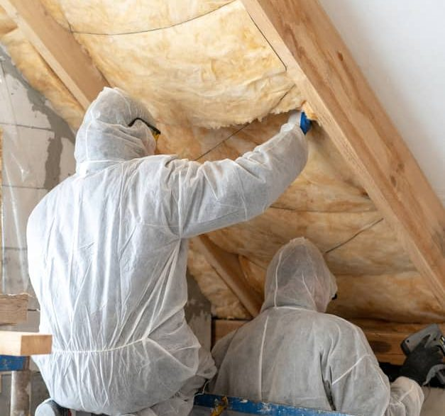 Mold Remediation Columbus investigating possible mold growth in the attic of a downtown apartment
